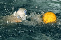 Water-polo - 2. The floating child and ball in water with sparks Royalty Free Stock Photography