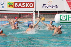 Water Polo. The goalkeeper tries to intercept a shooting royalty free stock photos