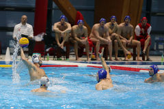 Water polo action - throwing the ball Royalty Free Stock Photo