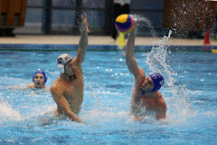 Water polo action - throwing the ball Stock Photo