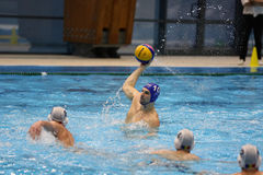Water polo action - throwing the ball Royalty Free Stock Photos