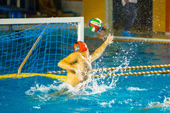 Water polo goal keeper. COMO, OCTOBER 18: G. Volarevic ( Bpm Sport Management, red cap ) in Como Nuoto - BPM Sport Management ( Italian Premier League) on stock photography