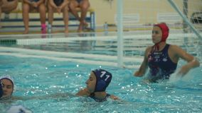 Water Polo Goal. St. Petersburg, Russia, 1 May 2018 Water polo World League, women Russian national team white caps and national team of Hungary blue caps, Water stock video