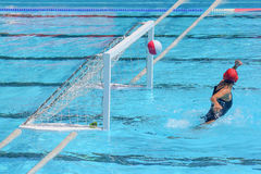 A water polo goalkeeper misses the ball going into the net of th Stock Photos