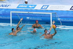 Water Polo / Hands Risen To Block. Turkish player tries to find a free space to shot on Romanian goal, but Romanian hands are highly risen to defend their net stock images