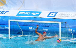Water Polo / Keeper / Brilliant Save. Virtuous Romanian goalkeeper blocked a shot and saved his net. Detail from the match Turkey - Romania 6:12, European Water royalty free stock photos