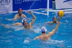 Water polo match Pro Recco - Barceloneta. SORI - ITALY - 26 MARCH 2014 - Unidentified players team in action during the water polo match between Pro Recco and stock image