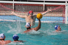 Water Polo shot. The goalkeeper tries to intercept a shooting. A shot in a game of water polo of the Italian championship - Feb 2008 Nervi - Posillipo playoffs stock photography