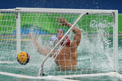 Water Polo Team Hungary in blue scores during Rio Olympics Men`s Preliminary Round Group A match against Team Greece Royalty Free Stock Photo