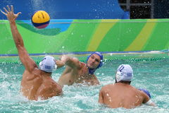 Water Polo Team Hungary in blue  and Team Greece in action during Rio 2016 Olympics Men`s Preliminary Round Group A match Royalty Free Stock Image