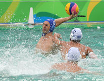 Water Polo Team Hungary in blue  and Team Greece in action during Rio 2016 Olympics Men`s Preliminary Round Group A match Stock Image