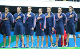 Water Polo Team USA during National Anthem before Rio 2016 Olympics Men`s Preliminary Round match against Team France Royalty Free Stock Image