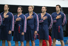 Water Polo Team USA during National Anthem before Rio 2016 Olympics Men`s Preliminary Round match against Team France Stock Photos