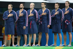 Water Polo Team USA during National Anthem before Rio 2016 Olympics Men`s Preliminary Round match against Team France Stock Photo