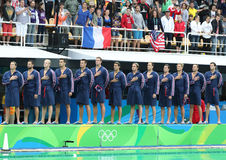 Water Polo Team USA during National Anthem before Rio 2016 Olympics Men`s Preliminary Round match against Team France Royalty Free Stock Images