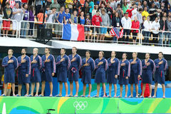 Water Polo Team USA during National Anthem before Rio 2016 Olympics Men`s Preliminary Round match against Team France Royalty Free Stock Photo