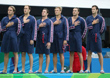 Water Polo Team USA during National Anthem before Rio 2016 Olympics Men`s Preliminary Round match against Team France Stock Image