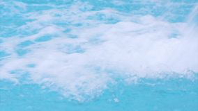 Water in pool. Flowing water in wellness and Spa swimming pool at aquapark. Close up footage stock video footage