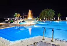 Water pool and fountain at night Royalty Free Stock Images