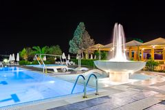 Water pool and fountain at night. Vacation background Stock Photos