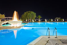 Water pool and fountain at night Royalty Free Stock Photo