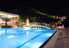 Water pool and fountain at night Stock Photo