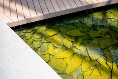 Water pool with rock stone on ground for decoration in garden or. Park. Landscape design Stock Photos