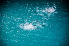 Water in pool splashing. Abstract art picture for background, wallpaper,screensaver, copy-space, add-text,water emotion is concept stock image