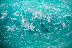 Water in pool splashing. Abstract art picture for background, wallpaper,screensaver, copy-space, add-text,water emotion is concept royalty free stock photography
