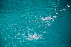 Water in pool splashing. Abstract art picture for background, wallpaper,screensaver, copy-space, add-text,water emotion is concept stock images