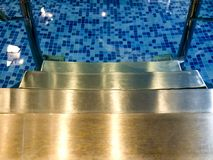 Water pool stairs indoors Stock Images