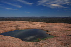 Water pool on top of enchanted rock Royalty Free Stock Photography