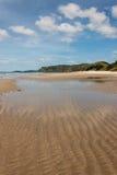 Water pools at Pakiri beach at low tide Royalty Free Stock Photo