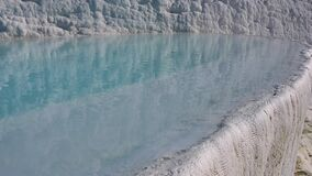Water in pools and travertine formations in Pamukkale, Turkey.  stock video footage