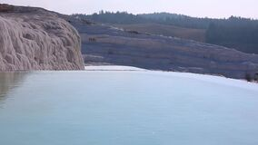 Water in pools and travertine formations in Pamukkale, Turkey.  stock footage