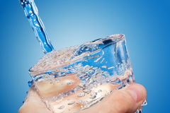 Water is poured in a glass Royalty Free Stock Images