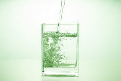 Water is poured into a glass glass Stock Photo