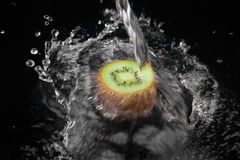 Water poured on an kiwi Stock Images