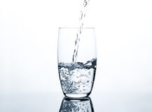 Water pouring into clear glass Stock Image