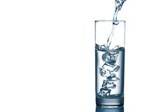 Water pouring. Copy-spaced image of pouring water in the glassware isolated on white stock photos