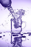 Water pouring Royalty Free Stock Photo