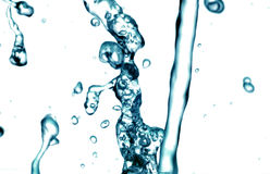 Water pouring down in blue Royalty Free Stock Image