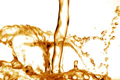 Water pouring down in gold Stock Photo