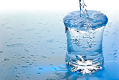 Water pouring in a glass Royalty Free Stock Photo
