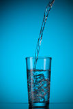 Water pouring into glass Stock Photography