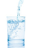 Water pouring into a glass. Water pouring into a glass, isolated on the white background, clipping path included Royalty Free Stock Photos