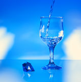 Water pouring into glass Royalty Free Stock Photo