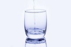 Water pouring into glass Stock Image