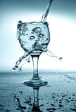 Water pouring into glass Stock Photos