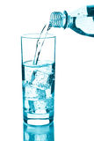 Water pouring into glass isolated Royalty Free Stock Photography